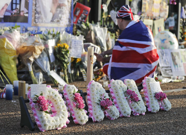 <p>A royal fan for the late Diana, Princess of Wales, stands outside Kensington Palace to pay tribute to her in London, Aug. 31, 2017. (Photo: Frank Augstein/AP) </p>