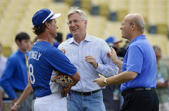 Dodgers owners Mark Walter, center, and Stan Kasten, right, talk with Los Angeles Dodgers manager Don Mattingly during batting practice prior to their baseball game against the Chicago Cubs, Monday, Aug. 26, 2013, in Los Angeles. (AP Photo/Mark J. Terrill)