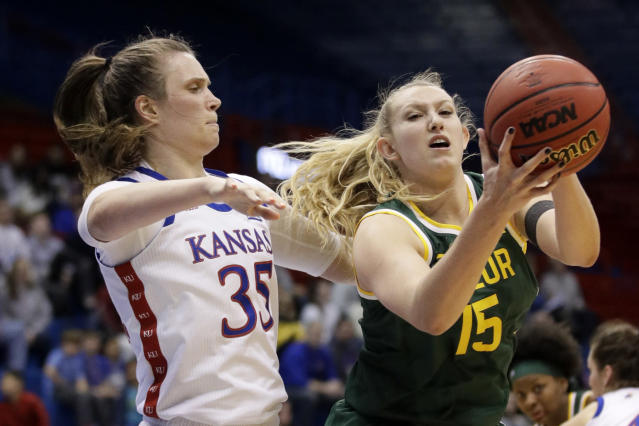 Baylor forward Lauren Cox (15) pulls in a rebound next to Kansas center Bailey Helgren (35) during the second half of an NCAA college basketball game in Lawrence, Kan., Wednesday, Jan. 15, 2020. (AP Photo/Orlin Wagner)