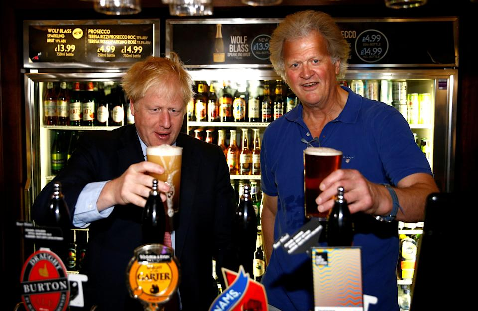 <p>Pulling another one: Boris Johnson meets pub group chairman Tim Martin at Wetherspoon's Metropolitan Bar in London</p> (Reuters)
