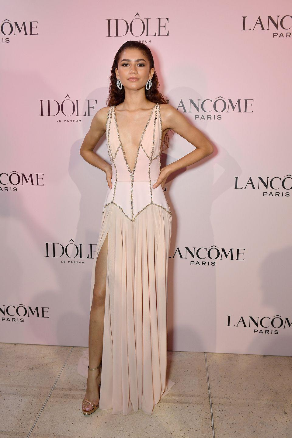 <p>When you're <em>the</em> face of a brand, you've got to show up to their events dressed to the nines. She looked ethereal in this pink gown for Lancôme's 'Idôle Fragrance' launch. The dress is by Georges Hobeika, and a pair of dazzling Chopard earrings really topped the look off.</p>