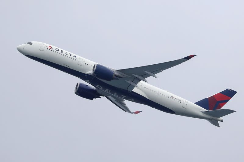A Delta Air Lines plane takes off from Sydney Airport in Sydney
