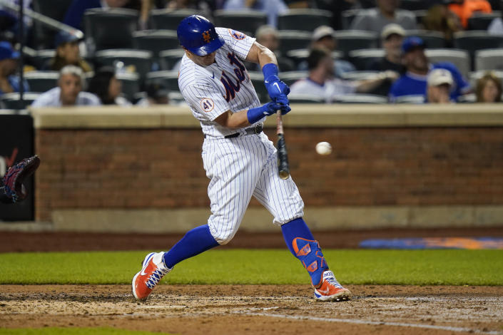 New York Mets' James McCann hits an RBI-single during the fourth inning of a baseball game against the Chicago Cubs, Monday, June 14, 2021, in New York. (AP Photo/Frank Franklin II)