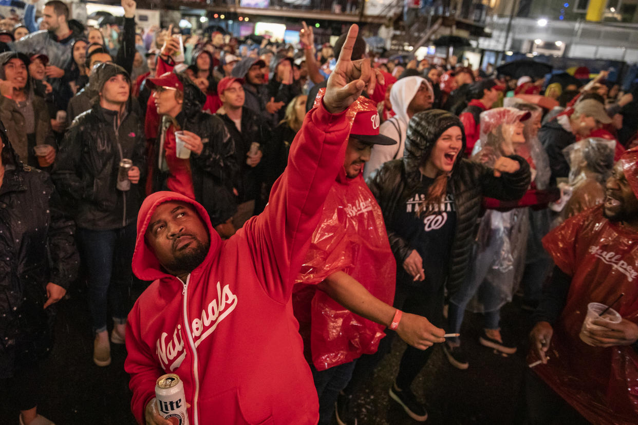 Fans braved the rain in and around Nationals Park for Game 7, and weren't pleased when Donald Trump showed up on the big screen. (Samuel Corum/Getty Images)