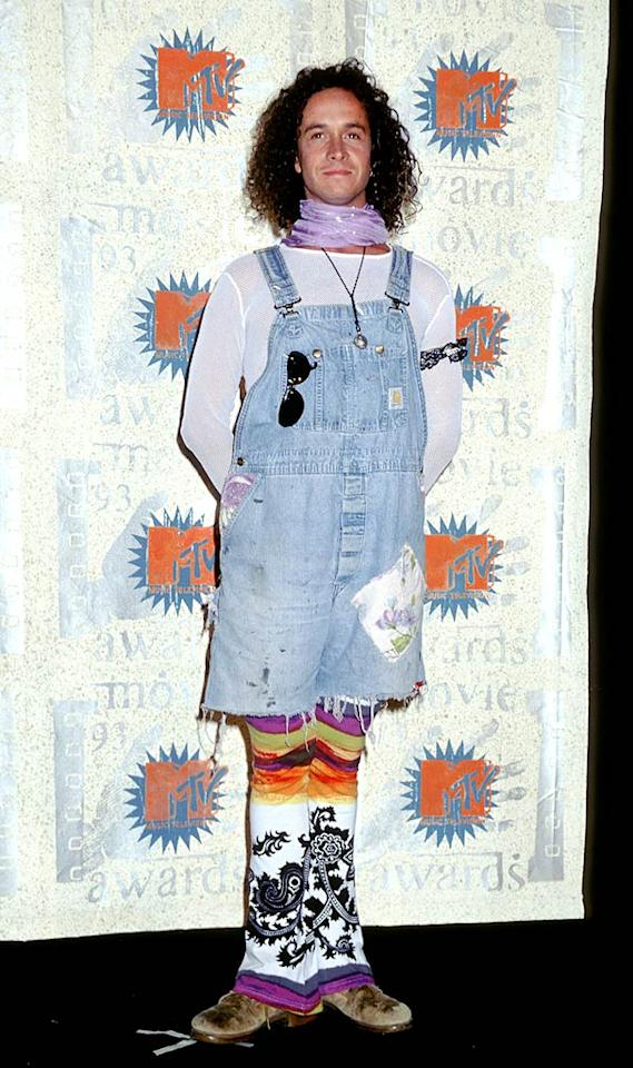 """By no means is this a pic of Pauly Shore in full-on grunge gear, but I just had to include it. The former MTV host and """"Son in Law"""" star's cutoff overalls and scraggly coif were totally on par with the trend, but can someone explain what's going on with the rest of his outrageous outfit? Ron Galella/<a href=""""http://www.wireimage.com"""" target=""""new"""">WireImage.com</a> - June 5, 1993"""