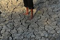 An indian local man crosses parched area of shrunken Varuna River during a hot day, in Phoolpur , some 45 kms from Allahabad on June 8, 2019. Much of India has been suffering from a heat wave for weeks along with a severe drought that has decimated crops, killed livestock and left at least 330 million Indians without enough water for their daily needs. (Photo by Ritesh Shukla ) (Photo by Ritesh Shukla/NurPhoto via Getty Images)
