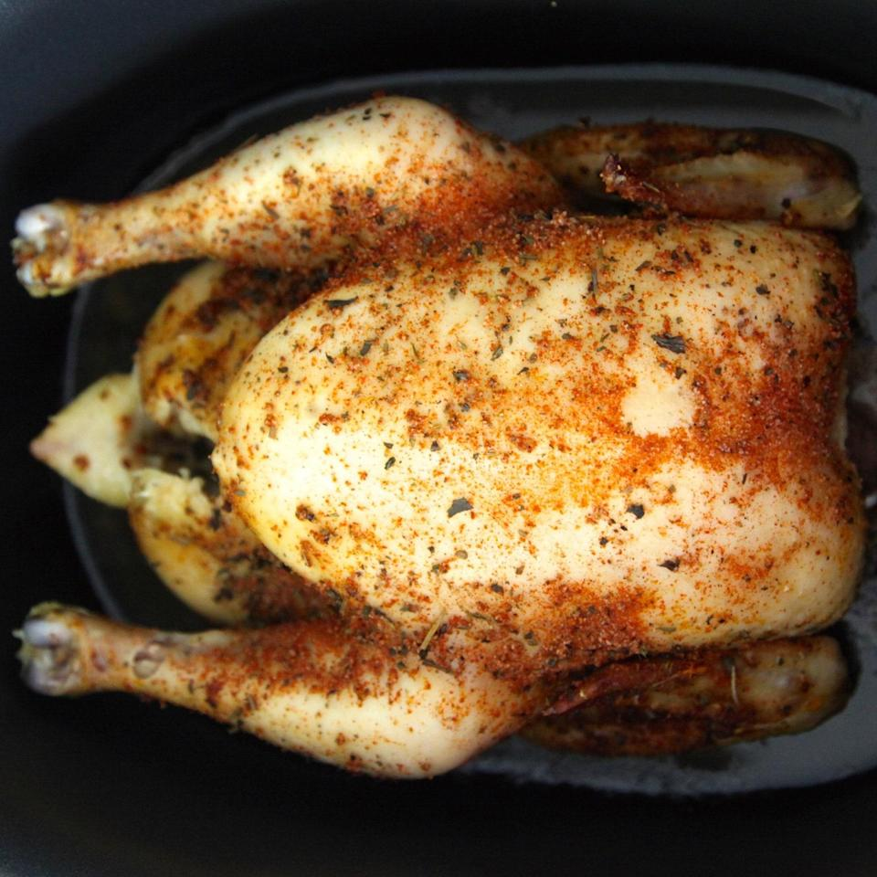 """Steaming a chicken in a slow cooker produces meat that is ridiculously moist and tender. Switch up the spices for whatever seasoning mix you like. <a href=""""https://www.epicurious.com/recipes/food/views/herbed-chicken-in-the-slow-cooker-56389484?mbid=synd_yahoo_rss"""" rel=""""nofollow noopener"""" target=""""_blank"""" data-ylk=""""slk:See recipe."""" class=""""link rapid-noclick-resp"""">See recipe.</a>"""