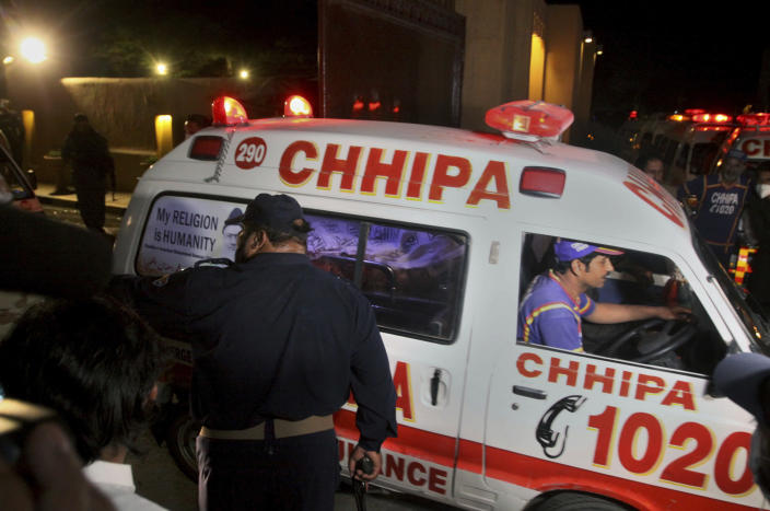 An ambulance transports an injured from the site of bomb blast in Quetta, Pakistan, Wednesday, April 21, 2021. A powerful bomb went off in the parking area of a five-star Serena hotel in the southwestern city of Quetta on Wednesday, wounding some people, police said. (AP Photo/Arshad Butt)