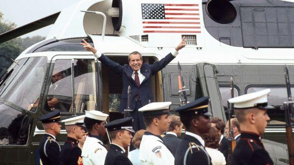 PHOTO: Richard Nixon smiles and gives the victory sign as he boards the White House helicopter after resigning the presidency, Aug. 9, 1974. (Bettmann Archive via Getty Images)