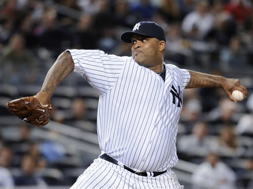 New York Yankees starting pitcher CC Sabathia throws to an Oakland Athletics batter during the second inning of a baseball game Friday, Sept. 21, 2012, at Yankee Stadium in New York. (AP Photo/Kathy Kmonicek)