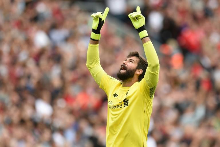 Liverpool's Brazilian goalkeeper Alisson Becker celebrates