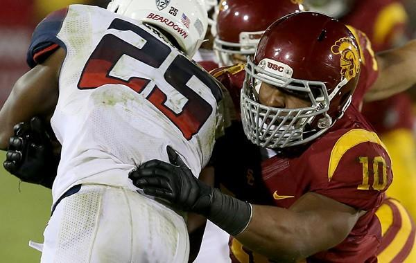USC linebacker Hayes Pullard takes down Arizona running back Ka'Deem Carey during a win in October. Pullard has learned plenty of lessons from his coaches and teammates over the years.
