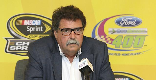 NASCAR president Mike Helton talks to the media during a news conference at the NASCAR championship weekend auto races in Homestead, Fla., Friday, Nov. 15, 2013. (AP Photo/Darryl Graham)