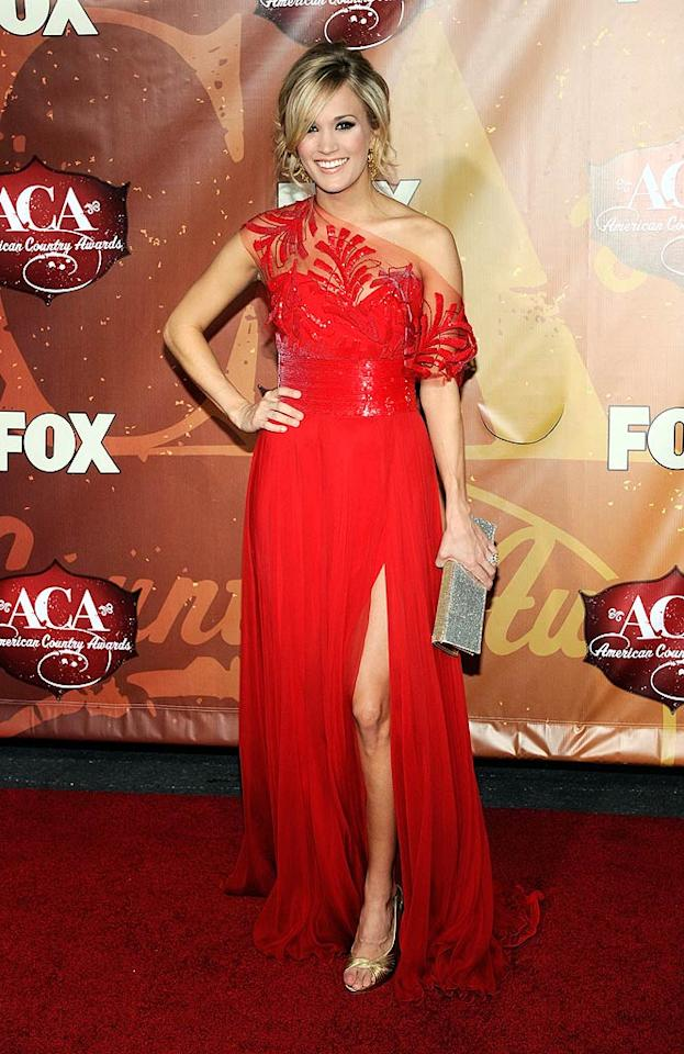 """Also spotted sporting a scarlet ensemble this week ... country cutie Carrie Underwood, who set the red carpet on fire in a fabulous Georges Chakra frock upon arriving at FOX's 1st annual American Country Awards in Las Vegas, Nevada. Ethan Miller/<a href=""""http://www.gettyimages.com/"""" target=""""new"""">GettyImages.com</a> - December 6, 2010"""