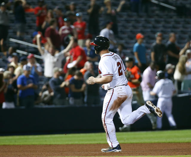 Atlanta Braves catcher Evan Gattis (24) rounds the bases after hitting a two-run home run in the 10th inning of a baseball game against the Miami Marlins Monday, April 21, 2014 in Atlanta. The homer gave the Braves a 4-2 victory. (AP Photo/John Bazemore)