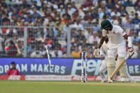Bangladesh's Ebadot Hossain looks back after being bowled out during the first day of the second test match between India and Bangladesh, in Kolkata, India, Friday, Nov. 22, 2019. (AP Photo/Bikas Das)