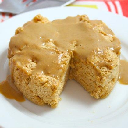 """<p>All you need are a few ingredients and a microwave to whip up this chewy PB dessert. Good thing it's meant for one—it's too delicious to share!</p> <p><b>Ingredients:</b><br /> 1 tablespoon plus 1 teaspoon peanut butter<br /> 3 tablespoons unsweetened almond milk<br /> 2 egg whites (for vegans, use 1 tablespoon egg replacer mixed with 4 tablespoons water)<br /> 2 tablespoons coconut flour<br /> 1/2 teaspoon baking powder<br /> 1 pinch salt<br /> Sweetener to taste</p> <p><b>Directions:</b><br /> 1. Place 1 tablespoon peanut butter and 2 tablespoons almond milk in a small microwaveable bowl or mug. Microwave for 45 seconds to 1 minute, stir, and let sit for a few minutes. Add remaining ingredients and stir until everything is evenly incorporated. Spoon batter into a greased mug and smooth out the top. Microwave for about 2 minutes, keeping a close eye on it since microwave cooking times vary so greatly. Let cool for a few minutes.<br /> 2. Meanwhile combine remaining 1 teaspoon peanut butter and 1 tablespoon almond milk in a small bowl. Microwave for 1 minute. Stir. If too thin, microwave another 15 seconds. Drizzle over cake.</p> <p><b>Nutrition score per serving:</b> 277 calories, 13g fat, 28g carbs, 15g protein</p> <p><i>Recipe provided by <a href=""""http://www.foodiefiasco.com/2012/07/08/all-for-one-peanut-butter-cake/"""" target=""""_blank"""">Foodie Fiasco</a></i></p>"""