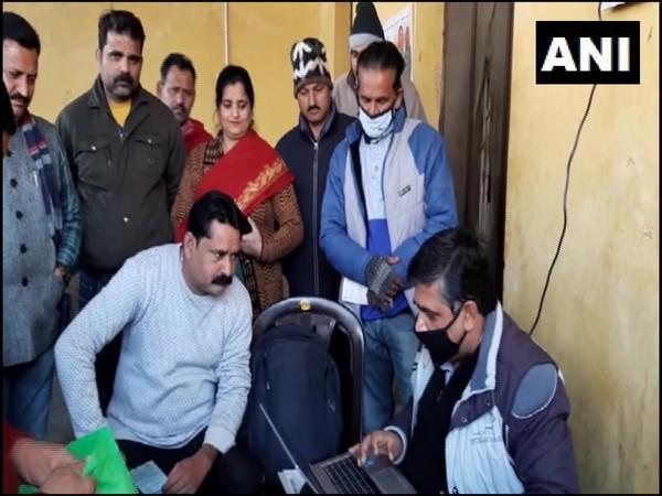 People during registration for 'Golden Card' to avail