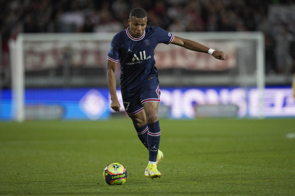 PSG's Kylian Mbappe runs with the ball during a French League One soccer match between Brest and PSG at the Francis-Le Ble stadium in Brest, France, Friday, Aug. 20, 2021. (AP Photo/Daniel Cole)