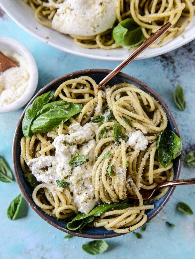 """<strong>Get the <a href=""""http://www.howsweeteats.com/2016/08/pesto-and-burrata-bucatini/"""" rel=""""nofollow noopener"""" target=""""_blank"""" data-ylk=""""slk:Pesto and Burrata Bucatini recipe"""" class=""""link rapid-noclick-resp"""">Pesto and Burrata Bucatini recipe</a>&nbsp;from How Sweet It Is</strong>"""