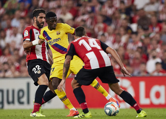 Barcelona's Ousmane Dembele, center, vies for the ball with Athletic Bilbao's Raul Garcia, left, and Athletic Bilbao's Dani Garcia during the Spanish La Liga soccer match between Athletic Bilbao and FC Barcelona at San Mames stadium in Bilbao, northern Spain, Friday, Aug. 16, 2019. (AP Photo/Ion Alcoba Beitia)