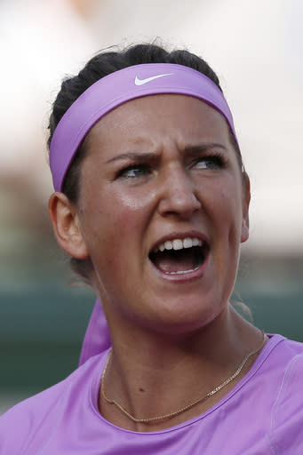 Belarus' Victoria Azarenka reacts as she plays Serena Williams of the U.S. during their third round match of the French Open tennis tournament at the Roland Garros stadium, Saturday, May 30, 2015 in Paris, France. (AP Photo/Christophe Ena)