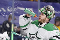 Dallas Stars goaltender Anton Khudobin takes a drink in the second period of an NHL hockey game against the Nashville Predators Sunday, April 11, 2021, in Nashville, Tenn. (AP Photo/Mark Humphrey)