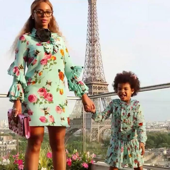 "<p>During the European leg of Beyoncé's <em>Formation</em> tour, Blue Ivy and her mom strike a series of poses in matching <a rel=""nofollow"" href=""http://click.linksynergy.com/fs-bin/click?id=93xLBvPhAeE&subid=0&offerid=254156.1&type=10&tmpid=6893&RD_PARM1=https%3A%2F%2Fwww.net-a-porter.com%2Fus%2Fen%2FShop%2FDesigners%2FGucci%3Fpn%3D1%2526npp%3D60%2526image_view%3Dproduct%2526dScroll%3D0&u1=ISHABEYPARIS"">Gucci dresses</a> in front of the Eiffel Tower, holding hands, jumping in the air, and blowing kisses.</p>"