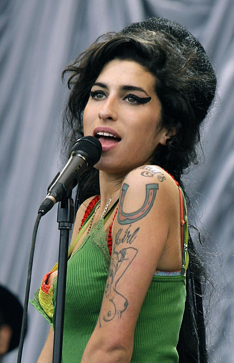 <b>Amy Winehouse (14 September 1983 to 23 July 2011)</b> <br><br>Singer Amy Winehouse had a short but incredibly successful career. Her two albums, 'Frank' and 'Back to Black', won critical praise as well as a plethora of awards. Famed for her unique voice and unrepentant attitude, Winehouse shot to stardom in 2003 after the release of debut album 'Frank', which went double platinum.<br><br>Critically as well as commercially successful, 'Frank' gained Winehouse an international following. Her second album 'Back to Black' proved to be even more successful – winning five Grammys. In particular the singles 'Rehab', 'Back to Black' and 'You Know I'm No Good' put Winehouse at the forefront of British music. Her cover of The Zutons song 'Valerie' was one of the biggest hits of 2007, spending 19 consecutive weeks in the UK top 20.<br><br>Despite her wildly successful music career, Winehouse had a troubled personal life. She suffered with drug and alcohol addiction for a number of years, as well as admitting problems with depression, self-harm and eating disorders. Her fractious relationship with ex-husband Blake Fielder-Civil also served up a number of flash points as their divorce was made public and splashed across the tabloids in 2009.<br><br>Winehouse's sudden death from alcohol poisoning in September shocked the nation, leaving thousands of fans mourning her loss.<br>