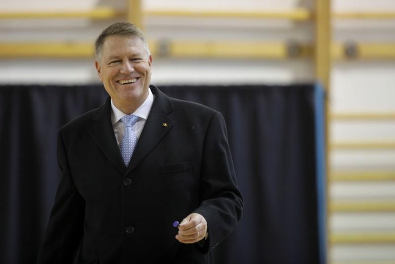 Incumbent candidate Klaus Iohannis reacts after casting his ballot in the second round of a presidential election