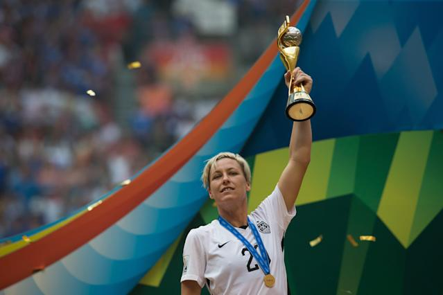 United States' Abby Wambach hoists the trophy after defeating Japan to win the FIFA Women's World Cup soccer championship in Vancouver, British Columbia, Canada, Sunday, July 5, 2015. (Darryl Dyck/The Canadian Press via AP) MANDATORY CREDIT