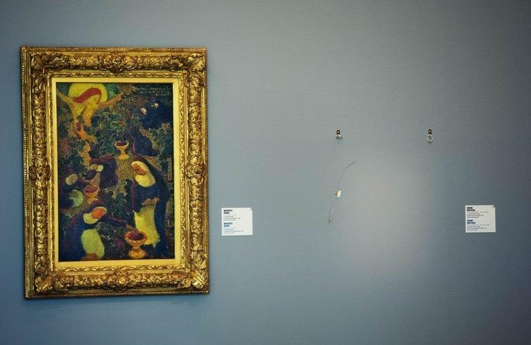 An empty spot stands on October 16, 2012, at the Kunsthal Museum in Rotterdam, where a painting by French artist Henri Matisse was stolen. Romanian police investigating the spectacular October theft of seven masterpieces from the Rotterdam museum searched the home of a fashion designer on Monday, a police source said