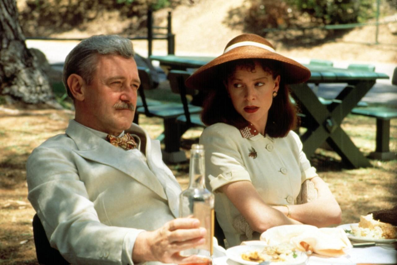<p>The legendary actress plays a scarlet-lipped secretary in this dark comedy that is centered around 1940s Hollywood. Buttoned up, brooding, and strong, her character, Audrey Taylor, suffers an unfortunate fate that is a turning point in the film.</p>