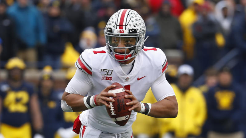 Ohio State quarterback Justin Fields rolls out to throw against Michigan in the first half of an NCAA college football game in Ann Arbor, Mich., Saturday, Nov. 30, 2019. (AP Photo/Paul Sancya)