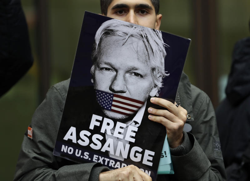 Supporters of Wikileaks founder Julian Assange demonstrate outside Westminster Magistrates' Court in London where Assange is expected to appear as he fights extradition to the United States on charges of conspiring to hack into a Pentagon computer, in London, Monday Oct. 21, 2019. U.S. authorities accuse Assange of scheming with former Army intelligence analyst Chelsea Manning to break a password for a classified government computer. (AP Photo/Kirsty Wigglesworth)