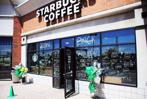 PHOTO: The Southtown Starbucks Coffee business, which was closed March 20, 2020, and reopened late last week, has a 'WELCOME BACK' to customers on the windows, May 11, 2020, in Bloomington, Minn, (Jim Mone/AP)