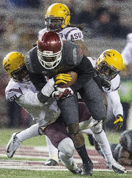 Arizona State defenders bring down Washington State wide receiver Kristoff Williams (18) during the second half of an NCAA college football game on Thursday, Oct. 31, 2013, at Martin Stadium in Pullman, Wash. Arizona State won 55-21. (AP Photo/Dean Hare)