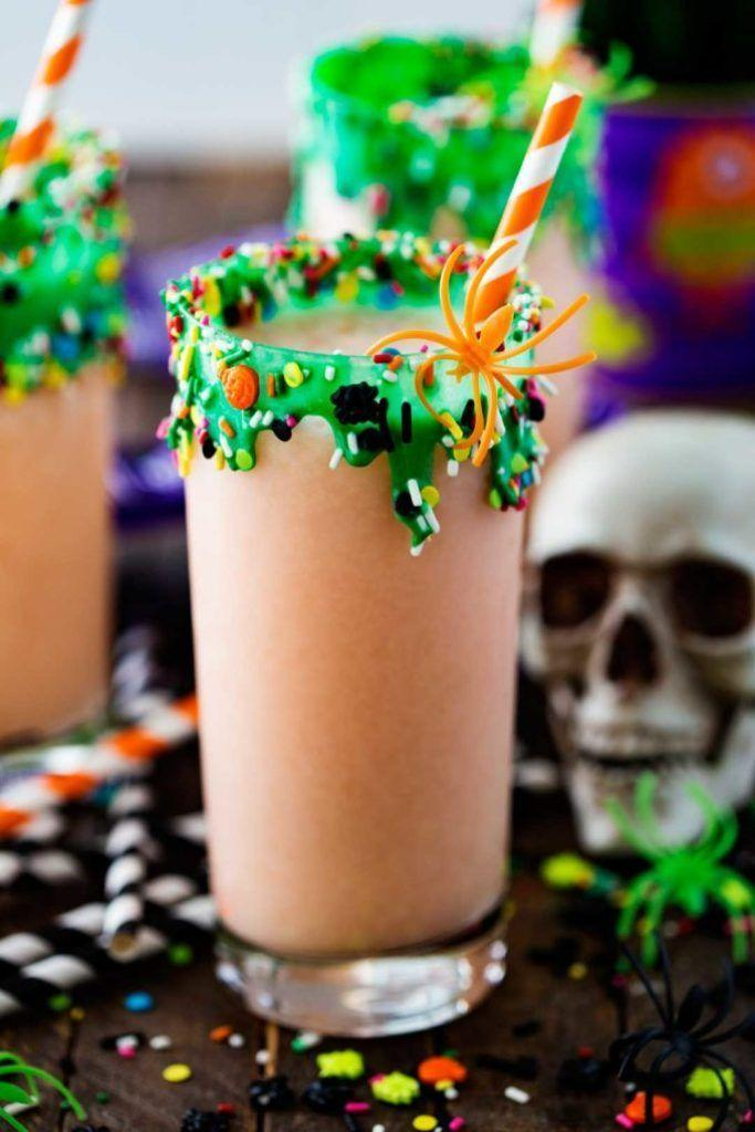 "<p>Don't skip garnishing the glass for this kid-friendly take on a piña colada. It's easier than it looks!</p><p><strong>Get the recipe at <a href=""https://www.eazypeazymealz.com/swamp-potion-halloween-punch/"" rel=""nofollow noopener"" target=""_blank"" data-ylk=""slk:Eazy Peazy Mealz"" class=""link rapid-noclick-resp"">Eazy Peazy Mealz</a>.</strong></p>"