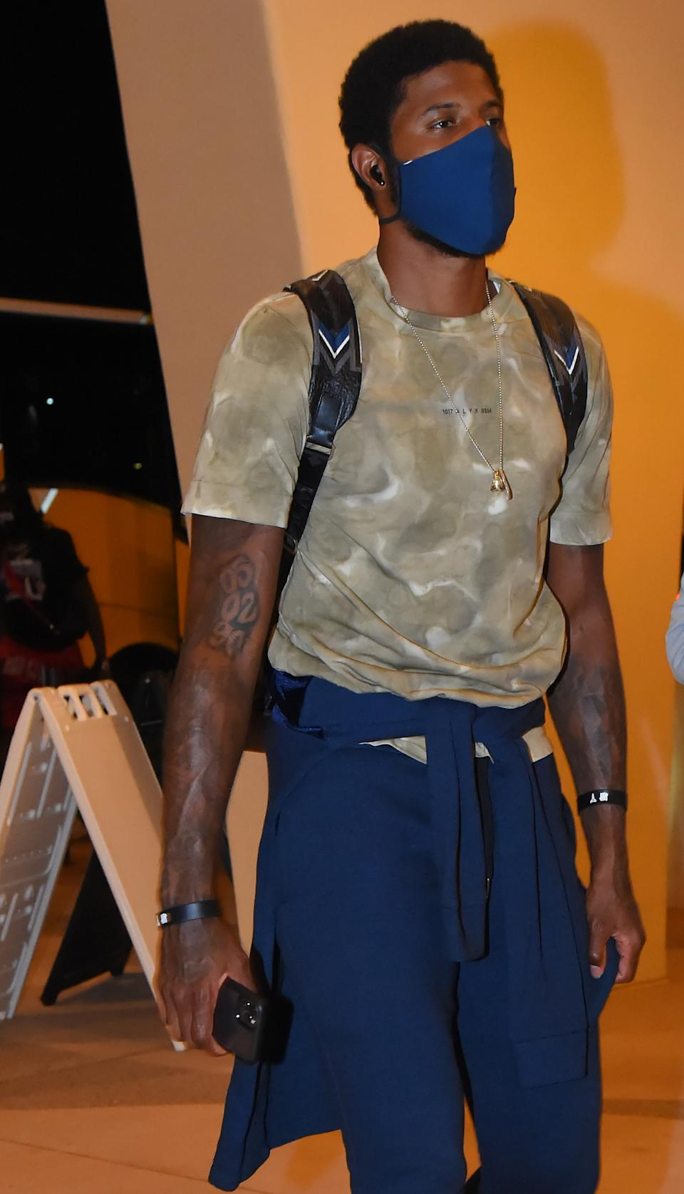 Paul George of the LA Clippers arrives at the hotel as part of the NBA Restart 2020 on July 8, 2020 in Orlando, Florida. (Photo by Bill Baptist/NBAE via Getty Images)