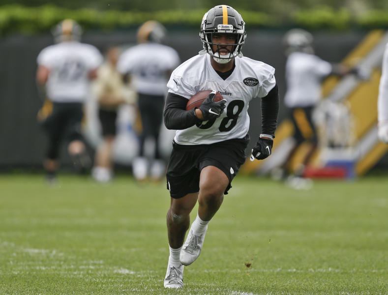 FILE - This file photo from May 22, 2018, shows Pittsburgh Steelers running back Jaylen Samuels (38) as he takes part in drills during NFL football practice in Pittsburgh. Steelers All-Pro Le'Veon Bell is spending his second straight spring working out on his own while waiting to sign his franchise tender. That leaves plenty of reps for potential replacements, from James Conner to rookie Jaylen Samuels. (AP Photo/Keith Srakocic, FILE)