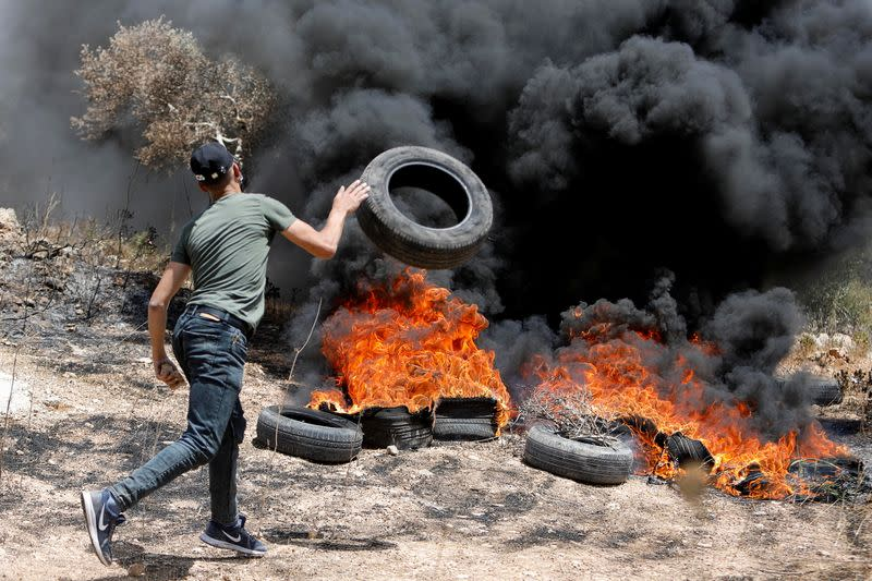Palestinians protest against Israeli settlements, in West Bank