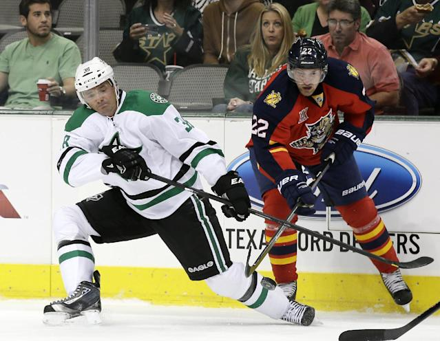 Dallas Stars' Vernon Fiddler (38) competes for control of the puck against Florida Panthers' Brad Boyes (22) in the first period of a preseason NHL hockey game on Wednesday, Sept. 18, 2013, in Dallas. (AP Photo/tony gutierrez)