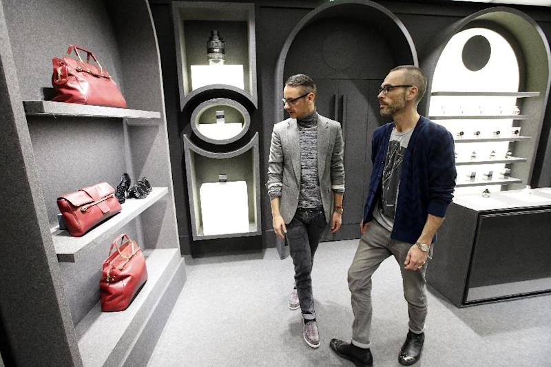Netherlands' fashion designers Rolf Snoeren, left, and Viktor Horstingllok in their new Viktor and Rolf shop in Paris, Wednesday, Dec. 11, 2013. Viktor&Rolf, the Amsterdam-based avant-garde fashion house, opens its first ever flagship boutique in France in Paris. (AP Photo/Francois Mori)