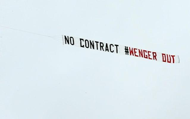 <span>Two aeroplanes flew over the Hawthorns with conflicting messages for Arsene Wenger</span> <span>Credit: EPA </span>