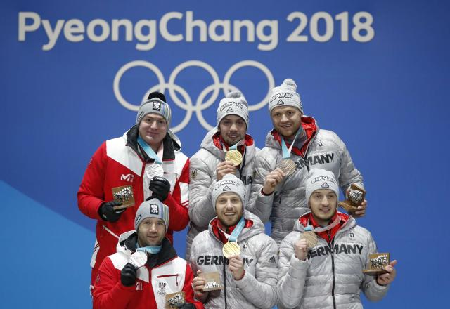 Medals Ceremony - Luge - Pyeongchang 2018 Winter Olympics - Men's Doubles - Medals Plaza - Pyeongchang, South Korea - February 16, 2018 - Gold medalists Tobias Wendl and Tobias Arlt of Germany, silver medalists Peter Penz and Georg Fischler of Austria and bronze medalists, Toni Eggert and Sascha Benecken of Germany on the podium. REUTERS/Kim Hong-Ji
