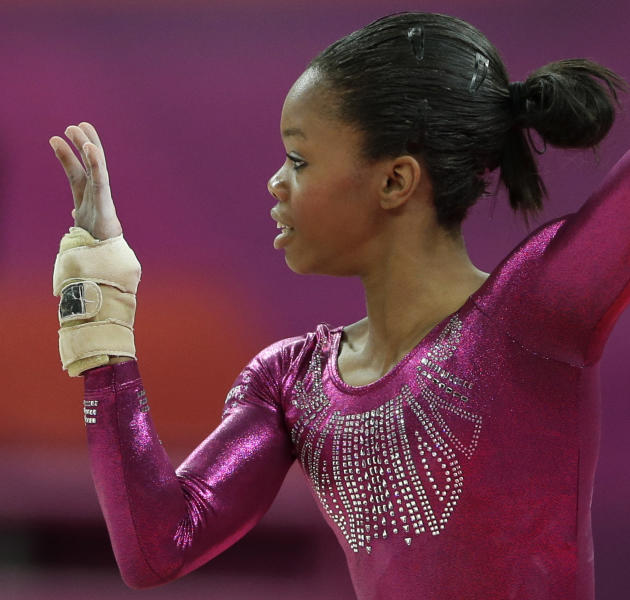 U.S. gymnast Gabrielle Douglas performs on the floor during the artistic gymnastics women's individual all-around competition at the 2012 Summer Olympics, Thursday, Aug. 2, 2012, in London. (AP Photo/Gregory Bull)