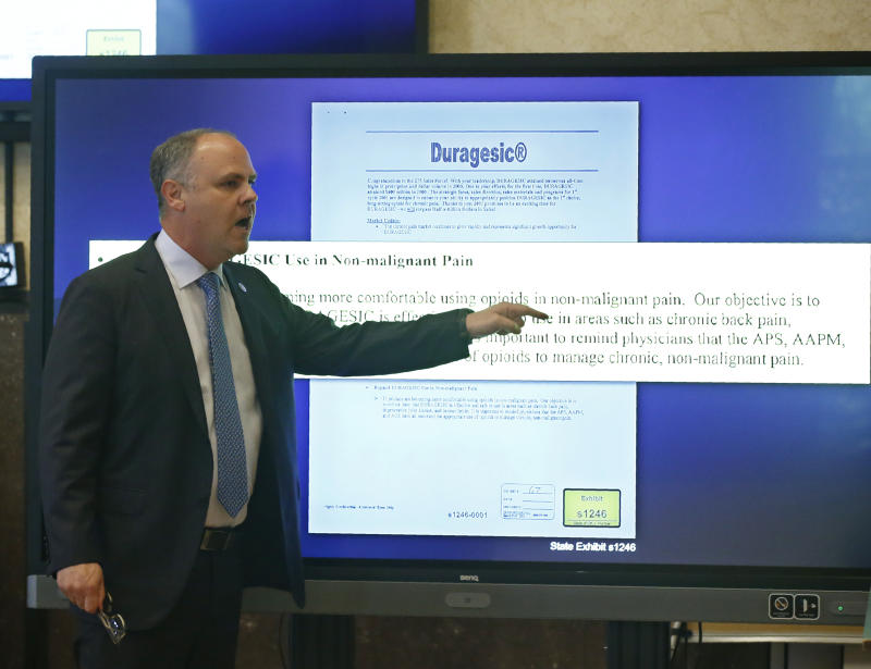 State's attorney Brad Beckworth speaks during closing arguments in Oklahoma's ongoing opioid drug lawsuit against Johnson & Johnson, Monday, July 15, 2019, in Norman, Okla. (AP Photo/Sue Ogrocki, Pool)