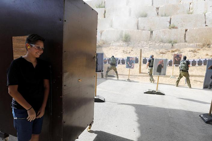 "<p>A tourist stands behind a booth as he takes part in a two hour ""boot camp"" experience, at ""Caliber 3 Israeli Counter Terror and Security Academy "" in the Gush Etzion settlement bloc south of Jerusalem in the occupied West Bank July 13, 2017. (Photo: Nir Elias/Reuters) </p>"