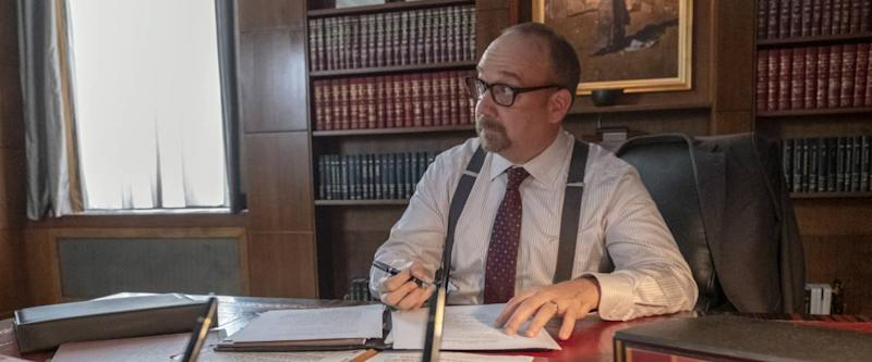 Paul Giamatti as Chuck Rhoades sitting at his desk