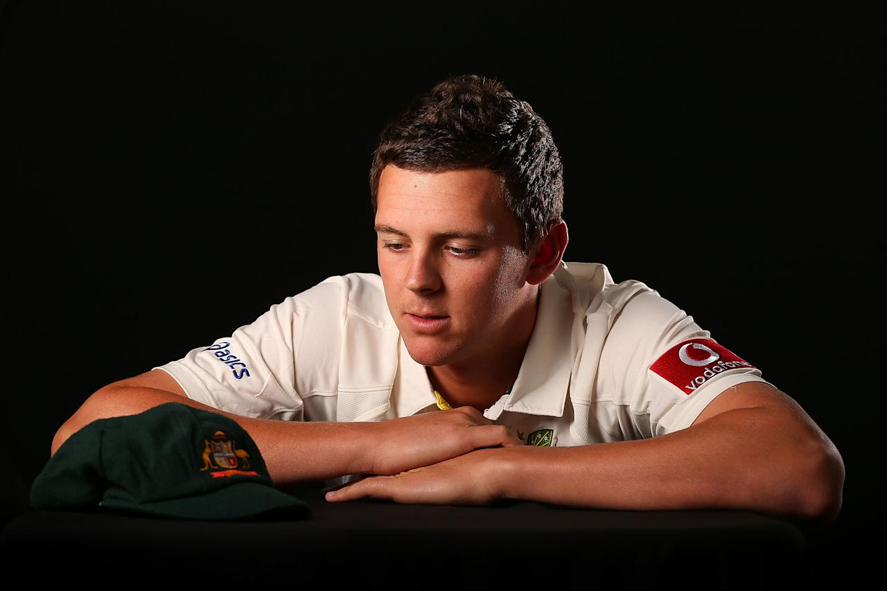 PERTH, AUSTRALIA - NOVEMBER 29:  Josh Hazlewood poses with a Baggy Green cap during an Australian Test squad portrait session on November 29, 2012 in Perth, Australia.  (Photo by Paul Kane/Getty Images)